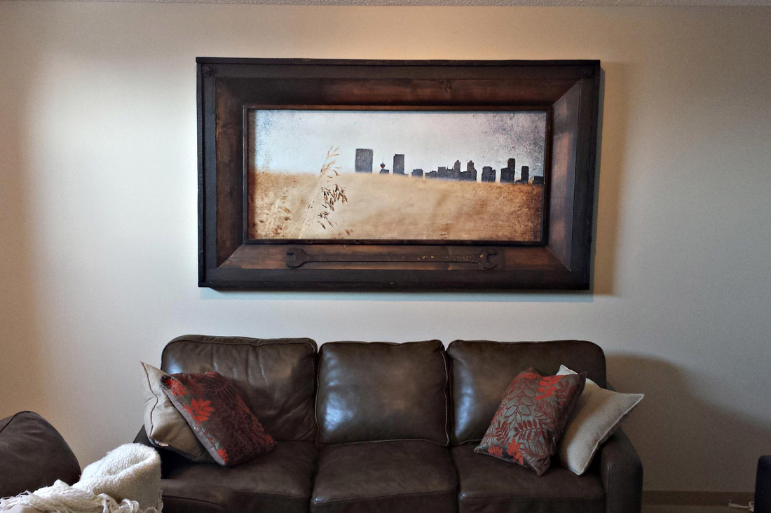 Original painting of Calgary Cityscape.  Brad is a Calgary artist and showcases his wort in Alberta art galleries mainly in Calgary and Edmonton.  Calgary and Edmonton Designers love his work and this piece is hung in a beautiful rustic Calgary Home.